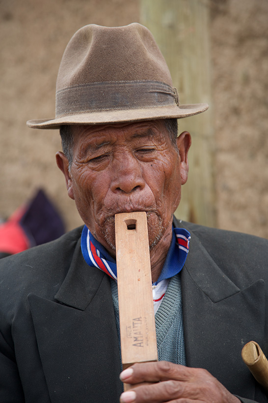 2x3_546x721_hh_bolivia_man_blowing_flute_us_english_web_v2.jpg